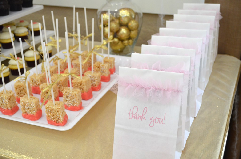 Use pretty take home goody bags as part of your dessert table decor // MyMommaToldMe.com