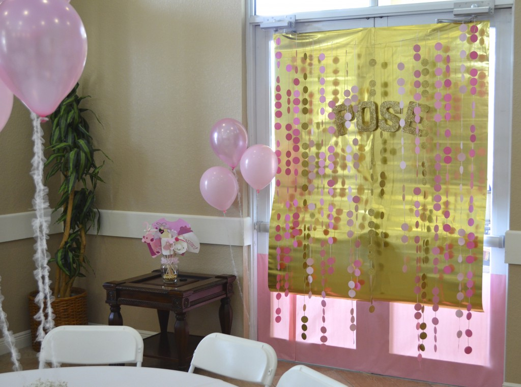 pink and gold baby shower photo booth after