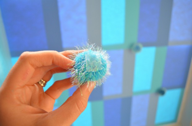 Frozen party backdrop tutorial adding pom poms MyMommaToldMe.com