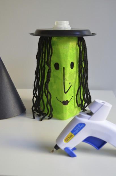 Halloween Milk Jug Witch craft tutorial attaching the hat glue gun MyMommaToldMe.com