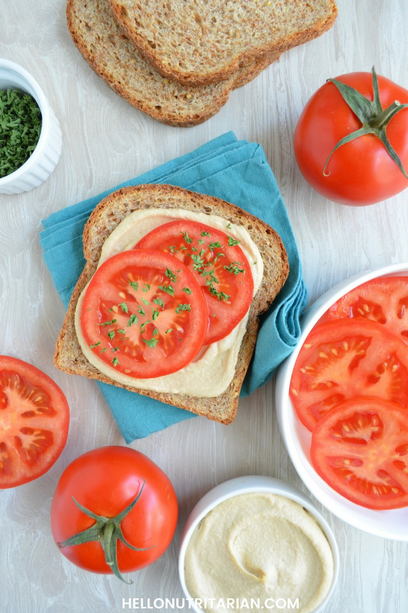 Nutritarian Bread Options Easy Sandwich Idea No Oil Hummus Fresh Tomatoes and parsley Hello Nutritarian