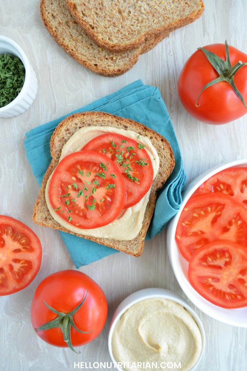 Nutritarian Bread Options Easy Sandwich Idea No Oil Hummus Fresh Tomatoes and parsley Hello Nutritarian